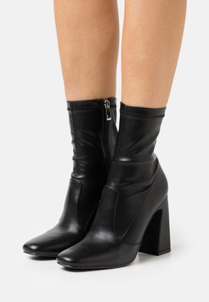 KYOMI - Classic ankle boots - black