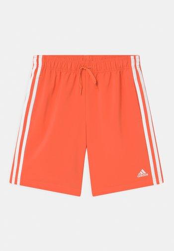 Sports shorts - orange/white