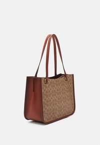 Coach - COATED SIGNATURE TYLER CARRYALL - Weekend bag - tan/rust - 2