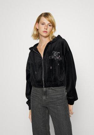 CLARA CREST HOODIE - Sweater met rits - black