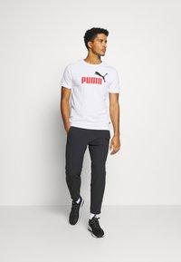 Puma - LOGO TEE - Print T-shirt - white - 1