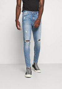 Jack & Jones - JJIPETE JJORIGINAL  - Jeans Tapered Fit - blue denim - 0