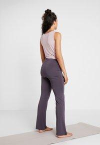 Curare Yogawear - LONG PANTS SKIRT - Tracksuit bottoms - aubergine - 2
