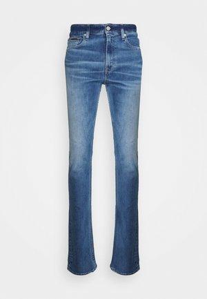SIMON SKINNY - Flared Jeans - denim