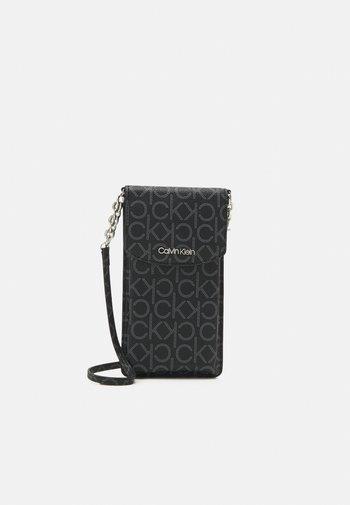 PHONE POUCH XBODY MONOGRAM - Across body bag - black