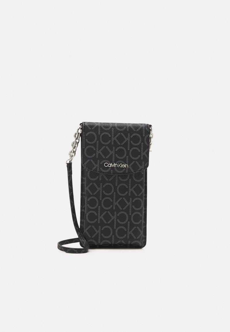 Calvin Klein - PHONE POUCH XBODY MONOGRAM - Across body bag - black
