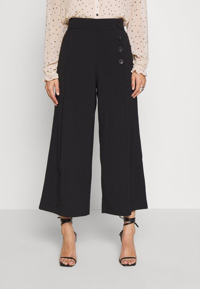 MINO - Pantalones - black