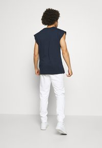 Champion - ROCHESTER CUFF PANTS - Spodnie treningowe - white - 2