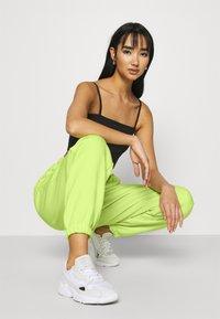 adidas Originals - PANT - Tracksuit bottoms - semi frozen yellow - 3