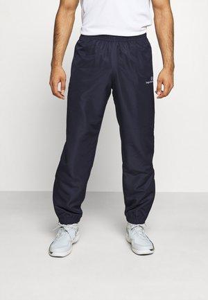 CARSON PANTS - Tracksuit bottoms - dark blue/white