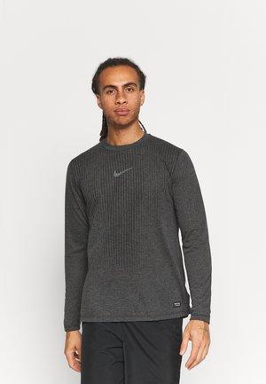 T-shirt de sport - black/iron grey