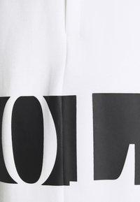 Polo Ralph Lauren - DOUBLE TECH - Tracksuit bottoms - white - 7