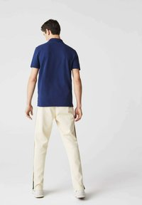 Lacoste - Polo shirt - bleu/beige - 1