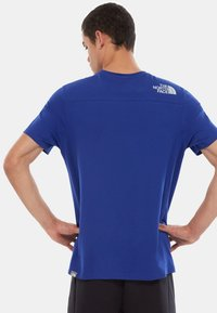 The North Face - M S/S LIGHT TEE - T-shirt med print - blue - 1