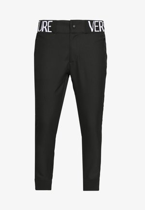 BAND LOGO TAILORED - Trousers - black