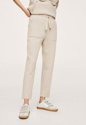 Pantalones deportivos - open beige