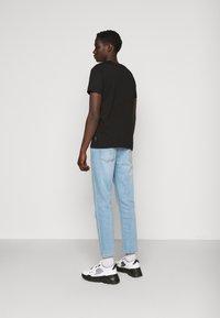 Versace Jeans Couture - FOIL - Print T-shirt - black - 2
