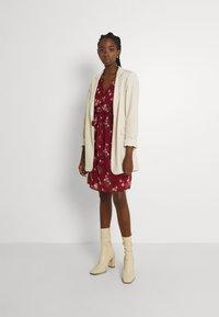 Vero Moda - VMFRAYA V NECK BALLOON DRESS - Shirt dress - cabernet - 1