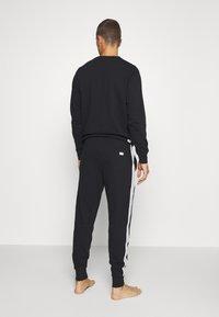 Diesel - UMLB-PETER TROUSERS - Pyjama bottoms - black - 2