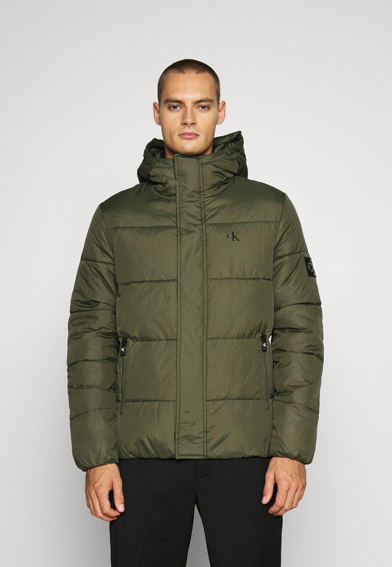 Calvin Klein Jeans - HOODED PUFFER JACKET - Winter jacket - deep depths