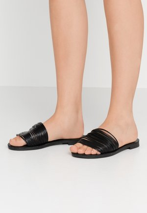 ONLMELLY STRING SLIP ON  - Sandalias planas - black