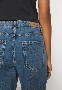 Gina Tricot - DAGNY HIGHWAIST - Jeans Tapered Fit - mid blue - 6
