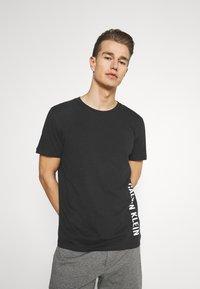 Calvin Klein Swimwear - INTENSE POWER CREW TEE - Undershirt - black - 0