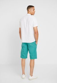 s.Oliver - RELAXED - Shorts - turmalin - 2
