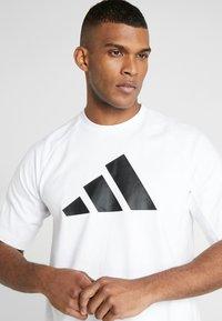 adidas Performance - MUST HAVE ATHLETICS SHORT SLEEVE TEE - Print T-shirt - white/black - 3