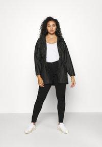 Vero Moda Curve - VMMALOU COATED - Waterproof jacket - black - 1