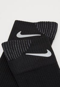 Nike Performance - SPARK CUSH - Sports socks - black/reflective - 1