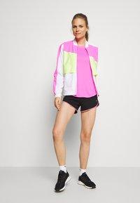 Puma - IGNITE TANK - Camiseta de deporte - luminous pink - 1