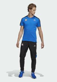 adidas Performance - SPACE TEE M - Sports shirt - fooblu - 1