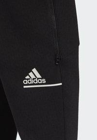adidas Performance - Tracksuit bottoms - black - 9