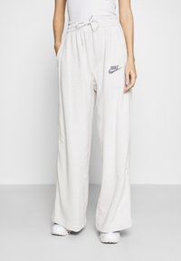 Nike Sportswear - Tracksuit bottoms - platinum tint - 0