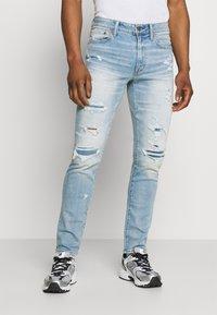 American Eagle - MEDIUM MOVE FREE - Slim fit jeans - getaway light - 0