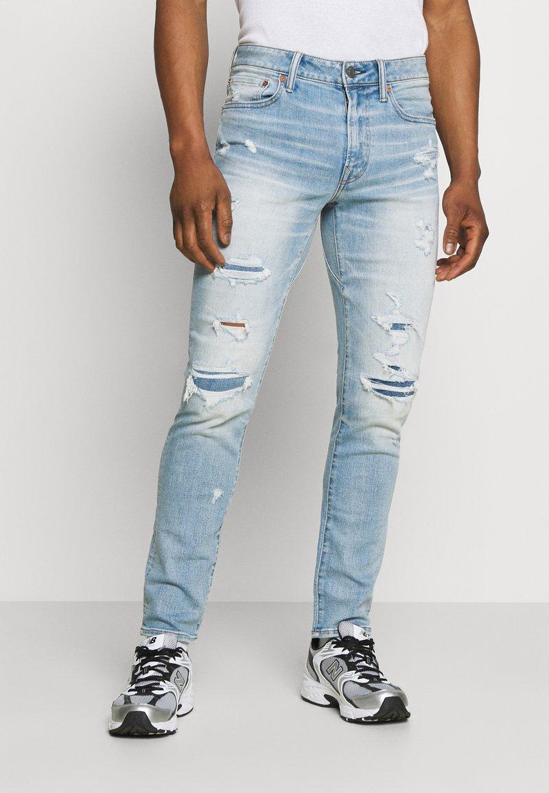 American Eagle - MEDIUM MOVE FREE - Slim fit jeans - getaway light