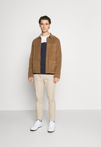 Tommy Jeans - SCANTON DOBBY TRACK PANT - Trousers - soft beige - 1