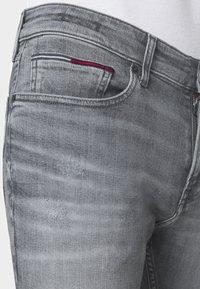 Tommy Jeans - SCANTON SLIM - Slim fit jeans - king iron grey - 4