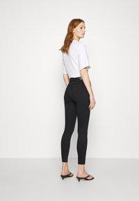 Calvin Klein Jeans - HIGH RISE SUPER SKINNY ANKLE - Jeans Skinny - washed black yoke - 2