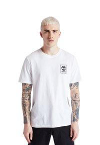 Timberland - SS BACK LOGO CAMO - Print T-shirt - white - 2