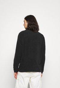 New Balance - ALL TERRAIN POCKET CREW - Fleece jumper - black - 2