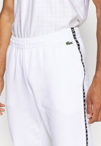 Lacoste Sport - PANT TAPERED - Träningsbyxor - white - 5