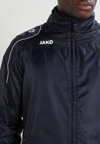 JAKO - TEAM - Waterproof jacket - marine - 6