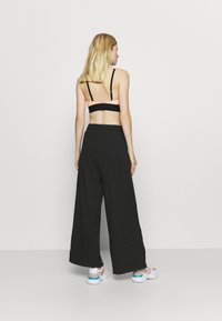 NU-IN - WIDE LEG SPLIT SEAM PANTS - Trainingsbroek - black - 2