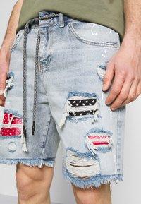 The Couture Club - BANDANA PATCH AND PAINT SPLAT CUT OFFS - Denim shorts - vintage blue - 5