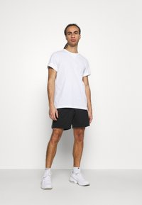 Champion - SHORTS - Sports shorts - black - 1