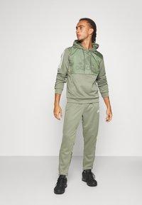 adidas Performance - MUST HAVES AEROREADY SPORTS REGULAR PANTS - Pantalon de survêtement - green - 1