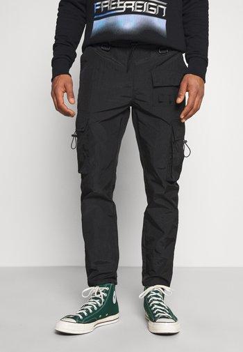 BLK TECH CARGO - Cargo trousers - black