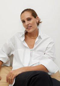 Mango - PROMISE - Button-down blouse - blanc cassé - 4
